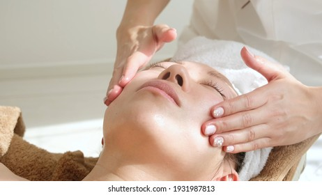 attractive japanese woman taking facial treatment