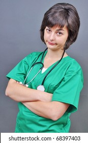 Attractive lady doctor on a over gray background