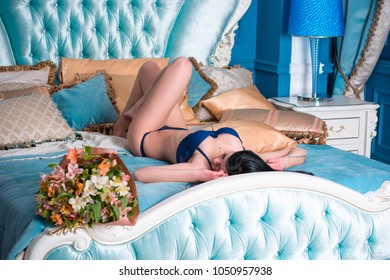 Attractive lady with thin figure posing at home interior. Lady wearing sensual lingerie. Seductive sexy brunette women, natural European vintage beauty