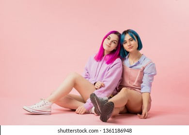 attractive lesbians looking at the camer, relationship, two sisters posing to the camera after visiting a hairdressing salon