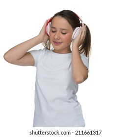 Attractive little girl enjoying her music on headphones standing with her eyes closed in bliss marking the beat with her fingers, isolated on white
