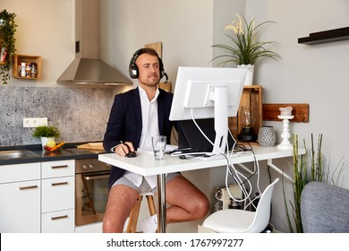 Attractive male entrepreneur on video call through computer while working at home
