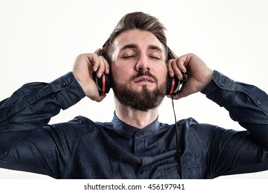 Attractive man with a beard and a headphone
