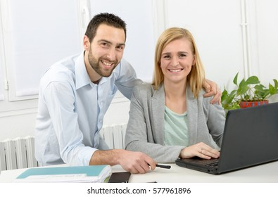 attractive man and beautiful woman business team using laptop computer
