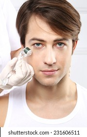 Attractive man in a beauty salon, micro needle mesotherapy treatment. Portrait of a young man groomed during the treatment in the beauty salon