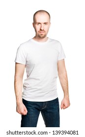Attractive man with clenched fists in white t-shirt and jeans isolated on white