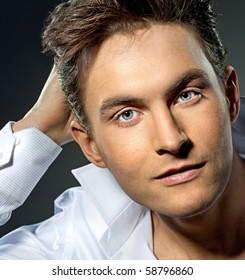 attractive man close up portrait on grey background