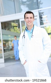 An attractive man doctor outside hospital building