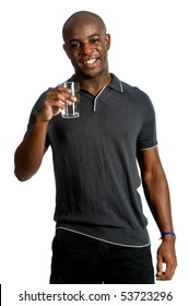 An attractive man drinking a glass of water against white background