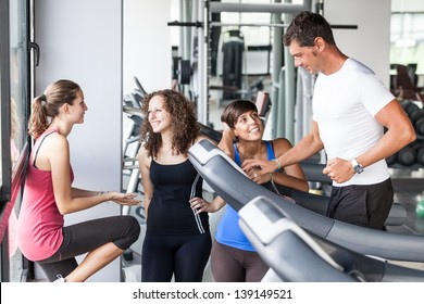 Attractive Man at Gym with Three Women