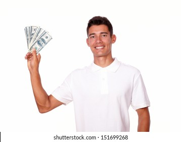 Attractive man is holding cash money in one hand, on isolated white background.