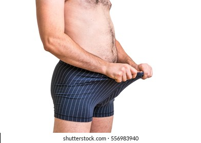 Attractive man is looking in his boxer underwear - impotence concept