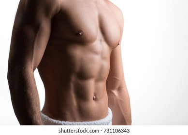 Attractive man is showing his trained body