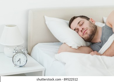 Attractive man sleeping in his bedroom