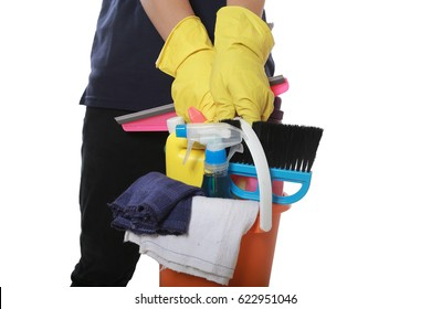 attractive man standing with cleaning product