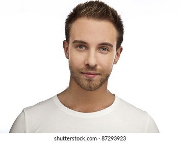 Attractive man wearing T-shirt close up portrait on white background.