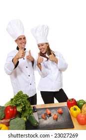 Attractive man and woman chefs celebrating success