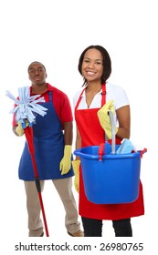 An attractive man and woman holding cleaning supplies