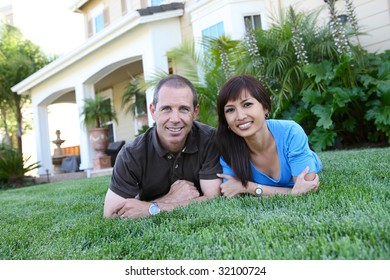An attractive man and woman husband and wife at home
