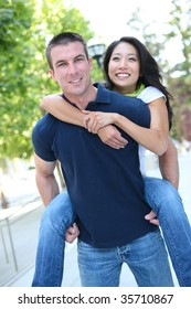 An Attractive man and woman Interracial couple in love  (Focus on Man)