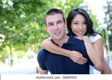 An Attractive man and woman Interracial couple in love