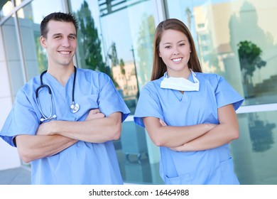 An attractive man and woman medical team at hospital office building