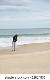 Attractive mature woman in deep thought at the beach