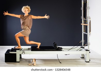 Attractive mature woman having exercise in evening dress