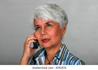 attractive mature woman listening on a cell phone