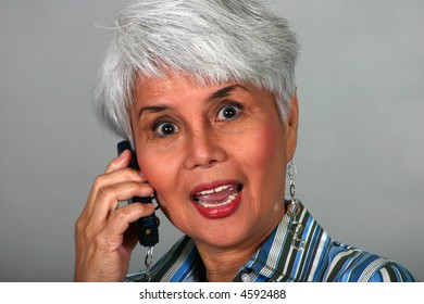 attractive mature woman talking on a cell phone