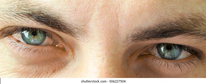 Attractive men's blue eyes.