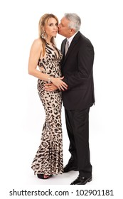 Attractive middle age couple in formal wear in an affectionate pose isolated on a white background.