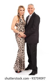Attractive middle age couple in formal evening wear isolated on a white background.
