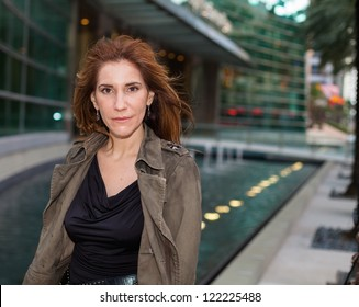 Attractive middle age woman in a outdoor downtown setting.