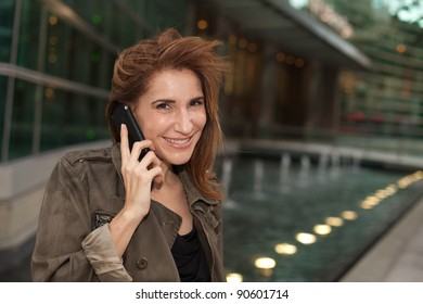 Attractive middle age woman outdoors in a metropolitan downtown urban setting.