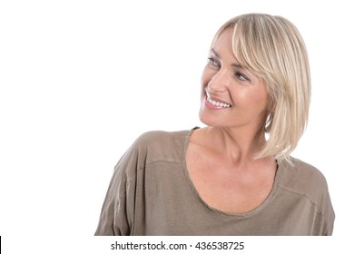 Attractive middle aged blond woman looking sideways to text.