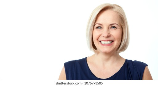 Attractive middle aged woman with beautiful smile on white background. Face close up