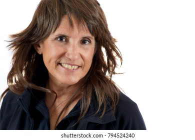 Attractive Middle aged woman with brown layered hair smiling isolated on white