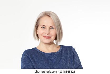 Attractive middle aged woman with folded arms emotionally posing in studio on white background