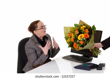 Attractive middle aged woman getting flowers for birthday, promotion, secretary day,  white background,  studio shot.