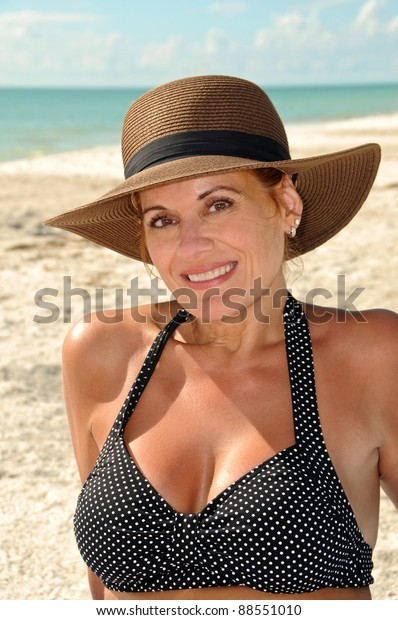attractive-middle-aged-woman-on-600w-885