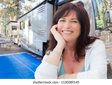 Attractive Middle Aged Woman Outdoor Portrait In Front of Class A RV.