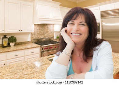 Attractive Middle Aged Woman Portrait Inside Kitchen At Home.
