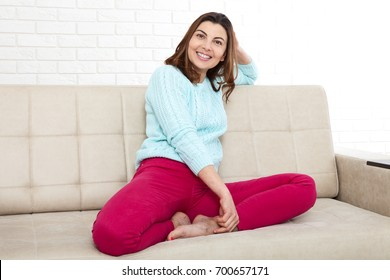Attractive middle aged woman relaxing at home. The beautiful face close up.