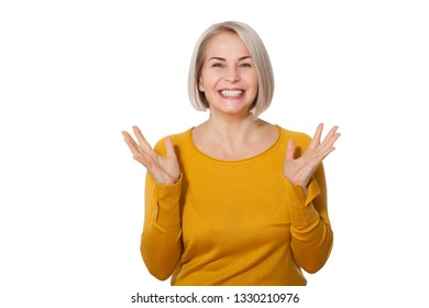 Attractive Middle Aged Woman Smiles emotionally posing in studio on white background