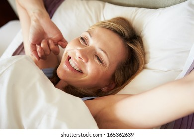 Attractive Middle Aged Woman Waking Up In Bed