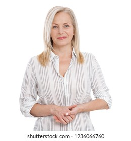 Attractive middle aged woman in white blouse with folded arms isolated on white background.