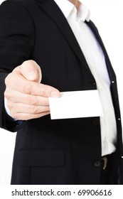 Attractive middle-aged man holding business card. All on white background.