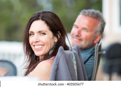 Attractive middle-aged man and woman outside