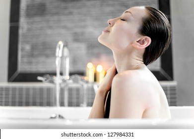 Attractive Mixed Asian Female enjoying the bath